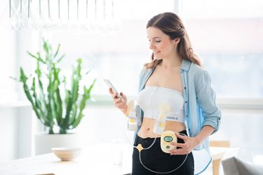 A mum tries hands-free pumping using the Medela Bustier, which enables her to work and pump at the same time.